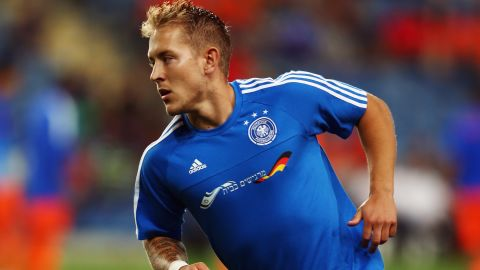 """Germany captain Lewis Holtby wears a specially made training shirt with the Israeli flag and the words """"Feeling at home"""" embroidered on the front to thank the host fans for making the team welcome at the European Under-21 Championship."""