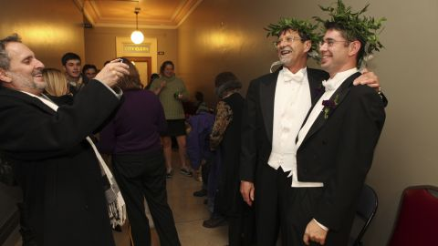 Jamous Lizotte, right, and Steven Jones pose for photos while waiting for a marriage license in Portland, Maine, on December 29, 2012.