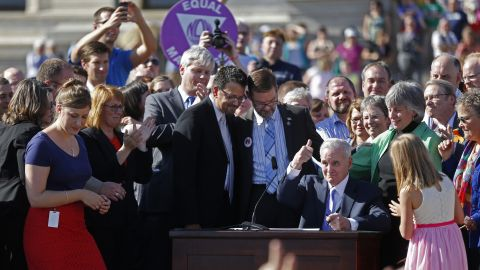 At the state Capitol in St. Paul, Minnesota, Gov. Mark Dayton signs a bill legalizing same-sex marriage on May 14, 2013.