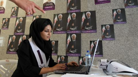A supporter of Hassan Rouhani, moderate presidential candidate and former top nuclear negotiator, works on her laptop in one of his campaign offices in Tehran on Tuesday, June 11.