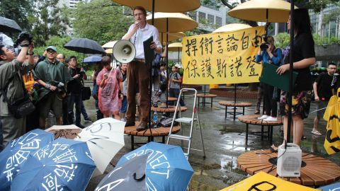 """""""We're rallying in order not to disappoint him and to ask Hong Kong to protect his well-being, not to extradite him, and to uphold Hong Kong law,"""" said blogger-activist and protest co-organizer Tom Grundy (L)."""