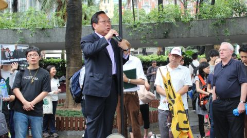 """Standing in Chater Garden in the city's business district, Hong Kong legislator Albert Ho said the protest was a """"march for justice."""""""