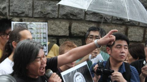 """Hong Kong legislator """"Long Hair"""" spoke to the crowd at the second rallying point outside the U.S. consulate."""