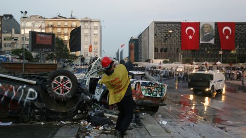 A protester throws rocks at police during clashes at the entrance of Gezi Park on June 15.