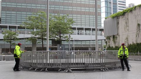 Police at the Hong Kong government headquarters in Tamar blocked off most of the square with two circles of fences, forcing protesters into a narrow outer perimeter.