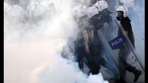 Police walk through tear gas during protests at Kizilay Square in central Ankara on June 16.