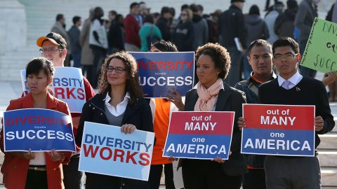 Protesters hold signs in front of the US Supreme Court on October 10, 2012, in Washington. The high court is scheduled to hear arguments on Fisher V. University of Texas at Austin and are tasked with ruling on whether the university's consideration of race in admissions is constitutional. (Photo by Mark Wilson/Getty Images)