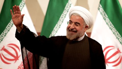 """Iranian President-elect Hassan Rouhani waves at a news conference in Tehran on Monday, June 17. Rouhani, a cleric and moderate politician, took more than 50% of the vote after campaigning on a platform of """"hope and prudence,"""" appealing to both traditional conservatives and reform-minded voters."""
