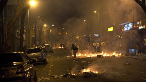 Piles of trash burn in the streets of Rio de Janeiro on June 17.