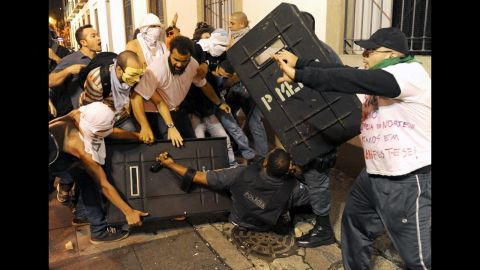 Protesters clash with riot police on June 17.