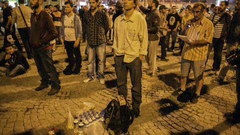 """Turkish performance artist Erdem Gunduz, center, is joined by others as he makes his silent protest in Taksim Square. As word of his gesture of protest spread, Gunduz became known as the """"standing man."""" Protests that began as a <a href=""""http://www.cnn.com/2013/06/17/world/europe/turkey-protests/index.html"""">demonstration against the planned demolition of a park</a> have grown into general anti-government dissent across the nation."""