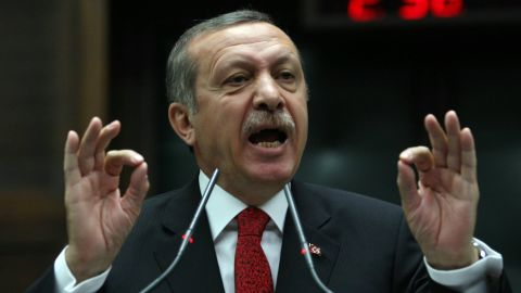 """Turkish Prime Minister Recep Tayyip Erdogan speaks to the deputies of his ruling Justice and Development Party during a meeting with Turkish parliament on Tuesday, June 18.  Erdogan said he had no intention of restricting anyone's democratic rights. """"If you want to make a protest do it, do it, but do it within the framework of law,"""" he said."""