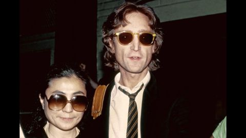 """On December 8, 1980, an armed man, Mark Chapman, staked out the Manhattan apartment building where former Beatle John Lennon lived with his wife, Yoko Ono, and their young son. After receiving a signed copy of Lennon's latest album as the singer was leaving his home, Chapman waited until the couple returned to the apartment that night and shot Lennon in the back with a revolver. In this photo taken earlier that year, Lennon and Ono stand outside of the recording studio where he recorded his final album """"Double Fantasy."""""""