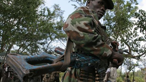 A member of the Lord's Resistance Army stands guard. The group is accused of poaching elephants in the Democratic Republic of Congo's Garamba National Park and using the profits to fund terror activities.