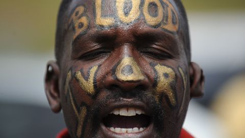 """A man with the words """"Blood Ivory"""" painted on his face protests in Nairobi with a group called Kenyans United Against Poaching."""