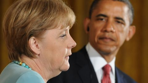 Barack Obama and German Chancellor Angela Merkel hold a joint press conference in the East Room in Washington, DC, June 7, 2011, as part of an official visit.