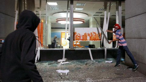 Hidden in the peaceful multitudes are bands of rowdies, leaving rubble in their wake, including this store in Sao Paulo on June 18.