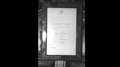 On display at the main gates of Buckingham Palace in London is the announcement that Diana gave birth to a son, William, at 9.03 p.m. on June 21, 1982. Charles was with her at St. Mary's Hospital for the birth of their first child, who weighed 7lbs 1.5 ozs and had blue eyes.<br />