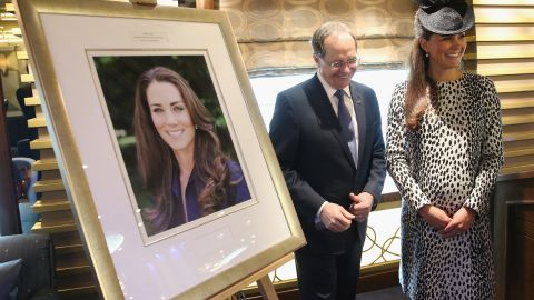 President and CEO of Princess Cruises Alan Buckelew escorts Catherine stands next to an image taken of herself by Getty photographer Chris Jackson after a ship's naming ceremony at Ocean Terminal on June 13, 2013 in Southampton. This was Catherine's final public appearance before she gives birth.