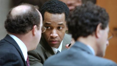 Muhammad talks with attorneys Peter Greenspun, left, and Jonathan Shapiro, right, during his trial in Virginia Beach on October 21, 2003.