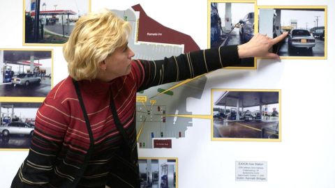 Witness Patricia Bradshaw points to her location on a photo taken at a shooting scene in Spotsylvania County, Virginia, as she testifies against John Allen Muhammad at the Virginia Beach Circuit Court in October 2003. The venues of the two men's trials had been moved, at the request of their attorneys, to locations more than 100 miles from the nearest shooting.