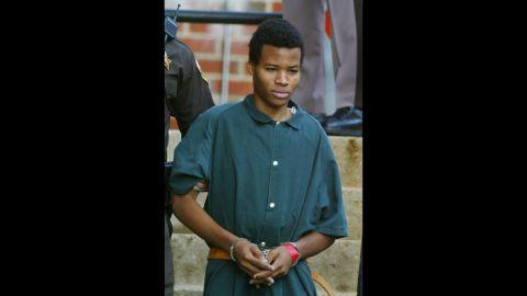 Malvo, 17, walks out of Fairfax County, Virginia, Juvenile Court on November 19, 2002.