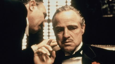 """<strong>""""The Godfather"""":</strong> Mario Puzo's 1969 novel chronicles the history of an immigrant and his family making their way in America as part of the Italian Mafia. It was made into an Oscar-winning 1972 film with Marlon Brando, and then expanded for 1974 and 1990 sequels."""