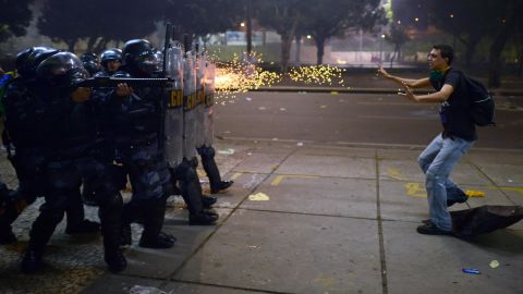 Police fire rubber bullets at a protester during clashes in Rio de Janeiro, Brazil, on Thursday, June 20.