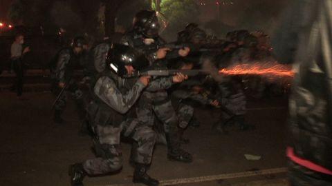 brazil protests tear gas running police_00011323.jpg