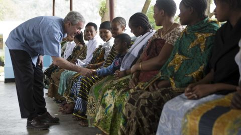President George W. Bush meets women and children at the reproduction and child health unit of Meru District Hospital in Arusha, Tanzania, on February 18, 2008.