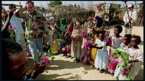 President George H. W. Bush meets people at a displaced persons camp in Mogadishu, Somalia, on December 31, 1992.