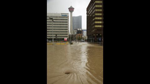 Floodwater swirls as a street stands empty during the mandatory evacuation on June 21.