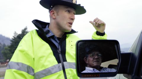 Colorado State Patrol Officer Jessie Bartunek speaks to a resident on the outskirts of South Fork on June 22.