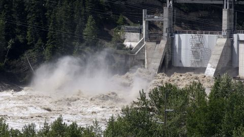 Bearspaw Dam opens the gates to release water into the flooded Bow River on June 22.