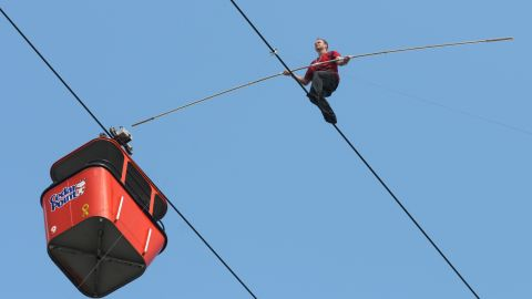 Wallenda walks one of the Sky Ride cables at the Cedar Point amusement park in Sandusky, Ohio, in July 2009.