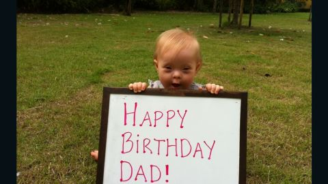 """Marley wishes her father a happy birthday. <a href=""""http://www.ndss.org/Down-Syndrome/What-Is-Down-Syndrome/"""" target=""""_blank"""" target=""""_blank"""">Down syndrome</a> occurs when a person has a full or partial extra copy of chromosome 21, which in turn alters the way their body develops."""