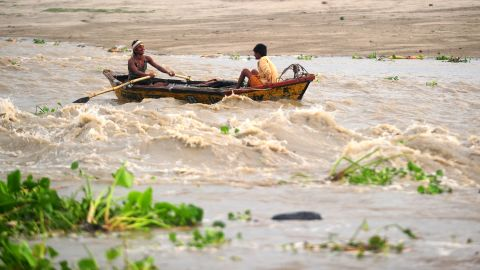 Indian boatman cross a fast moving river in Allahabad on June 24, 2013. The monsoon, which covers the subcontinent from June to September, usually brings some flooding. But the heavy rains arrived early this year, catching many by surprise and exposing a lack of preparedness. AFP PHOTO / SANJAY KANOJIA (Photo credit should read Sanjay Kanojia/AFP/Getty Images)