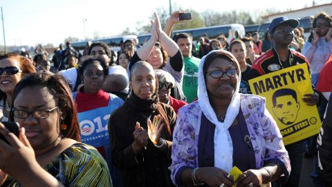 """A conservative judge called the Voting Rights Act a racial entitlement but supporters of the act say it is the crowning victory of the civil rights movement. Pictured, people gather for a post-march rally after crossing the Edmund Pettus Bridge on the """"Bloody Sunday"""" anniversary, March 4, 2012."""