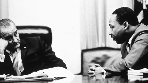 """President Lyndon Johnson, pictured here discussing the act with the Rev. Martin Luther King Jr. in 1965, went on national television to call for passage of the Voting Rights Act. He ended his speech by saying, """"And we shall overcome."""""""