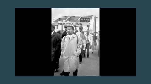 """John Lewis, a young activist who later became a congressman of Georgia, heads to a fateful encounter on the Edmund Pettus Bridge in Selma, Alabama during a 1965 march. Lewis was brutally assaulted by state troopers during the """"Bloody Sunday"""" march that made voting rights a national issue."""