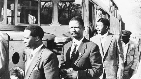 From left: Patrick Molaoa, Robert Resha and Mandela walk to the courtroom for their treason trial in Johannesburg.