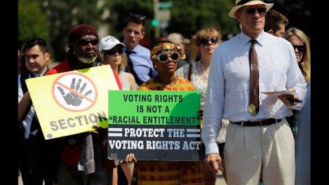 Supporters of the Voting Rights Act listen to speakers discussing the rulings outside the U.S. Supreme Court building on Tuesday, June 25, 2013.