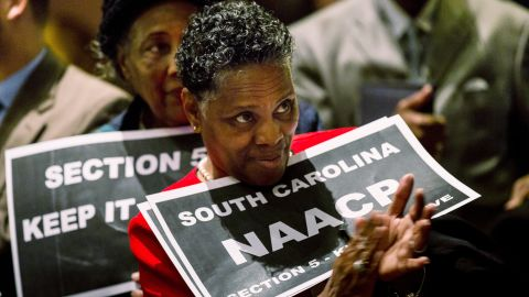 A supporter of the Voting Rights Act  rallies in the South Carolina State House in Columbia on February 26, 2013, the day before oral hearings at the Supreme Court.