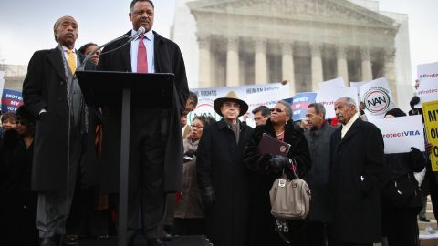 The Rev. Jesse Jackson, at the microphone, and the Rev. Al Sharpton, left, deliver remarks during a rally outside the U.S. Supreme Court on February 27, 2013, as the court prepared to hear oral arguments in Shelby County v. Holder, the legal challenge to Section 5 of the Voting Rights Act.