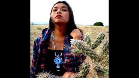 """Paul Frank Industries is collaborating with four Native American artists on a limited edition line of clothing and accessories, set to debut in August.<br /><br />Autumn Dawn Gomez is a jewelery designer from the Comanche/TaosPueblo/Navajo tribes. For """"Paul Frank Presents"""" she is designing accessories influenced by various landscapes that have impacted her life. Gomez is seen here wearing a medallion she created using hama fuse beads."""