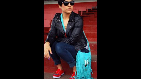 """Candace Halcro is an accessories designer from the Plains Cree/Metis tribe. She is skilled in Native American beading and <a href=""""http://www.etsy.com/people/brownbeadedcom"""" target=""""_blank"""" target=""""_blank"""">specializes in sunglasses</a>. Halcro will be applying her beading craft to Paul Frank sunglasses for the collection. She's seen here wearing beaded shoes, a purse and sunglasses that she created."""