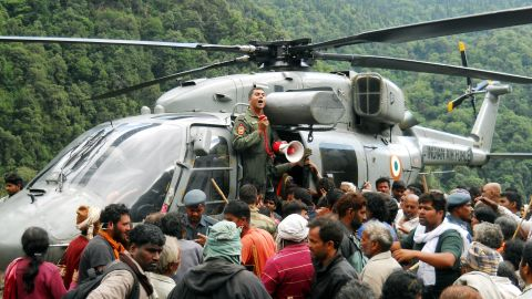 Indian pilgrims wait to board a helicopter to be evacuated after being stranded because of heavy flooding from near Kedarnath, Uttarakhand on June 24, 2013.