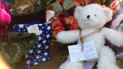"""A note, seen on June 26, tied around the neck of a teddy bear reads: """"Thanks for everything you've done for our country."""""""