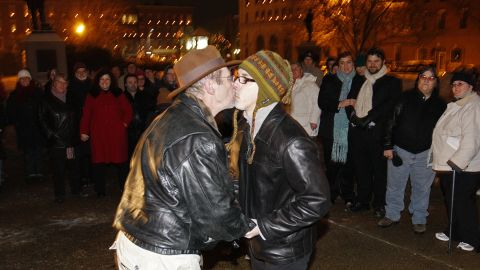 Olin Burkhart, left, and Carl Burkhart kiss on the steps of the New Hampshire Capitol on January 1, 2010, after the state's law allowing same-sex marriage went into effect.
