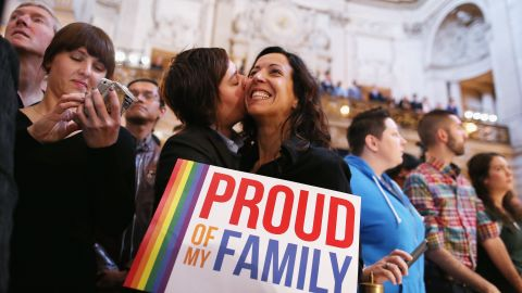 A couple celebrates at San Francisco City Hall upon hearing about the U.S. Supreme Court rulings on same-sex marriage on June 26, 2013. The high court cleared the way for same-sex couples in California to resume marrying after dismissing an appeal on Proposition 8 on jurisdictional grounds. The court also struck down a key part of the Defense of Marriage Act, a 1996 federal law defining marriage as between a man and a woman.